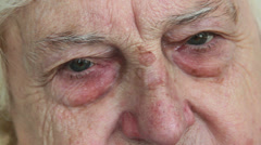 Old woman's face. Closeup. Stock Footage