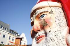 Closeup Santa Claus figure face in city environment Stock Photos