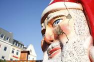 Stock Photo of closeup Santa Claus figure face in city environment