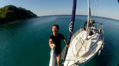 Man on sailing boat Stock Footage
