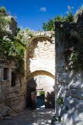 medieval gate of les baux de provence - stock photo