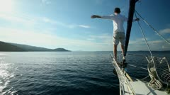 Man standing on the bow of sailing boat on Mediterranean sea. - stock footage