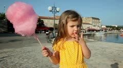 Girl eating candy floss Stock Footage