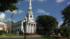 White church on main street in small town America Stock Footage