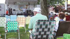 Elderly Couple at outdoor concert venue Stock Footage