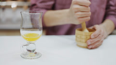 Refines the components of a cocktail barman in a mortar and pestle Stock Footage