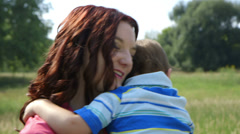 Young mother hugging her toddler Stock Footage