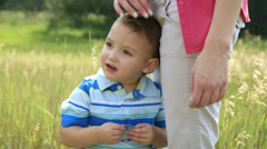 Mother holding her little boy close to her Stock Footage
