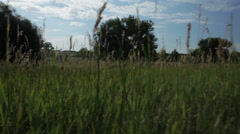 Crane up to farmer working in the distance Stock Footage