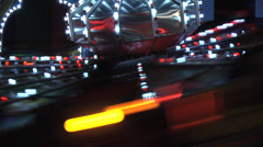Spinning train fair ground ride, nightime, slo motion, slo shutter. Static MS Stock Footage