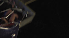Stock Video Footage of Octopus fair ground ride slo motion nightime, Extreme close up
