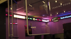 Double glass doors closing on trading room at university Stock Footage