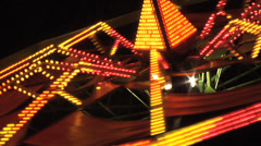 Octopus fair ground ride real time at night.  Close up of lights Stock Footage