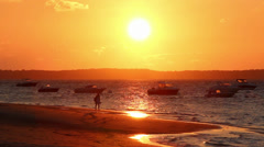 Woman walking alone in the sunset beach - 1080p Stock Footage