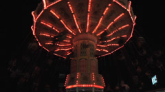 TiltaWhirl fair  ride at night.  double normal speed  push in to end of ride Stock Footage