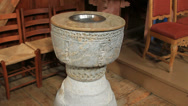 Stock Video Footage of Norwegian stave church baptismal font tilt up to pulpit ca 1250