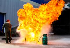 fire-fighter trains extinguishing a fire - stock photo
