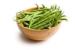 fresh green beans in wooden bowl - stock photo