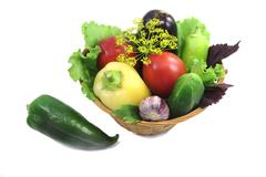 basket with fruits and vegetables , photographed on a white background. - stock photo