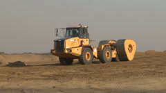 Earthworks mechanical compactor PAL - stock footage