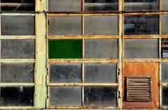 Windows of an old abandoned factory Stock Photos