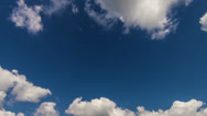 Stock Video Footage of White clouds slowmotion timelapse on the blue sky