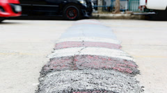 Closeup to control speed small hill marker on street Stock Footage