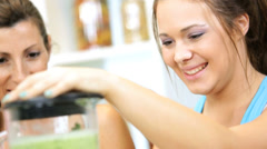 Caucasian Females Blender Fresh Vegetable Workout Drink - stock footage