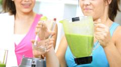 Caucasian Females Preparing Gym Drinking Healthy Vegetable Smoothie Stock Footage