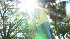 Happy Baby Held High Young Father Sun Flare Stock Footage