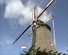 Dutch windmill milling - low angle Stock Footage