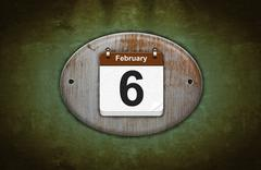 Old wooden calendar with february 6. Stock Illustration