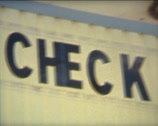 Stock Video Footage of SUPER 8 check out sign