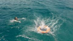 Lifeguard rescuing drowning girl Stock Footage