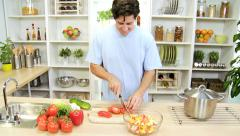Stock Video Footage of Healthy Caucasian Male Slicing Fresh Vegetables