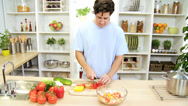 Stock Video Footage of Caucasian Male Kitchen Preparing Fresh Vegetarian Meal