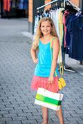 teenage girl shopping in an european city - stock photo