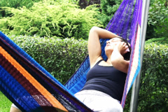 Woman with the cellphone receiving bad news in a hammock, slow motion at 240fps - stock footage