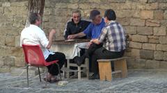 Playing backgammon in Baku Old City, senior men, Azerbaijan Stock Footage