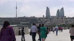Baku promenade and Flame Towers, people strolling, relaxing, Azerbaijan Stock Footage