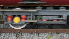 Carriages and Steam Engine Wheels Passing By Stock Footage