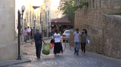 People walk through Old City in Baku Stock Footage