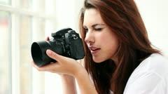 Photographer woman taking photographs Stock Footage