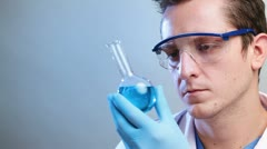 Scientist doing medical research on bio fuels - stock footage