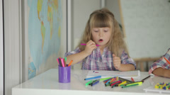 Two little girls drawing with colored pencils at drawing class and smiling - stock footage