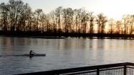 Stock Video Footage of Kayaker paddling along a lazy river