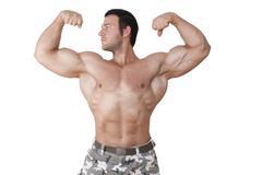 bodybuilder posing isolated. - stock photo
