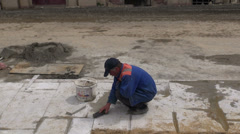 Construction worker, cleaning new pavement, Baku Stock Footage