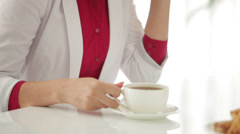 Beautiful young woman drinking tea and smiling Stock Footage
