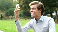 Happy man video messaging chat mobile phone Stock Footage